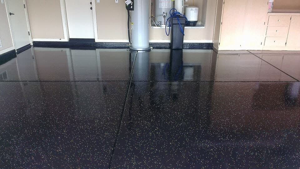 Black epoxy floor with white speckles